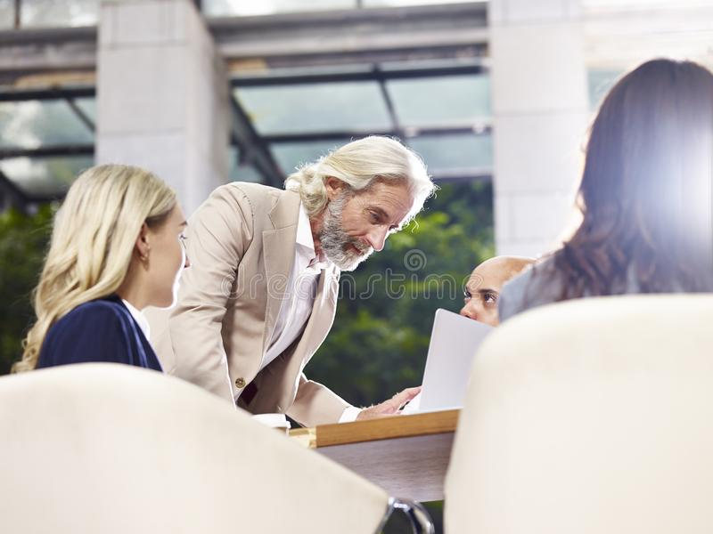 Multinational and multiethnic corporate business people meeting stock photo