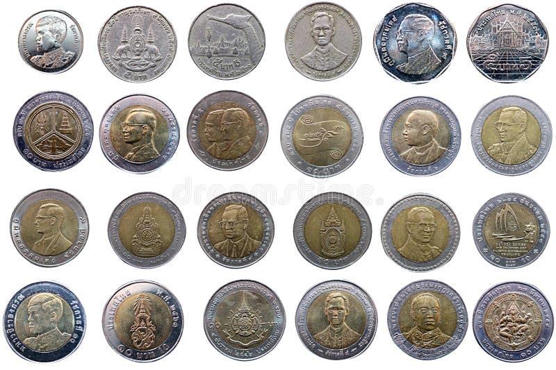 Multipeln skriver och modellerar av mynt för thailändsk baht på isolerade vita lodisar arkivfoton