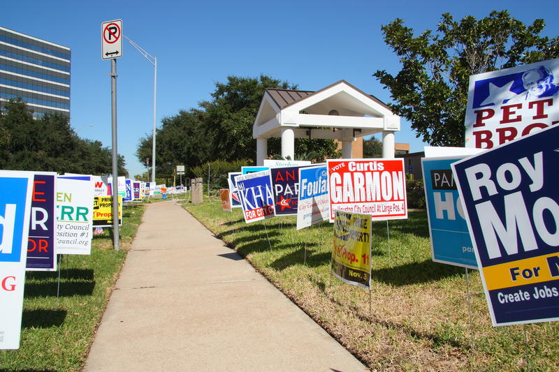 Multiple campaign signs at voting location. Campaign signs at early voting location in Houston Texas (Tracy Gee Community Center). Early voting in Houston lasts royalty free stock photography