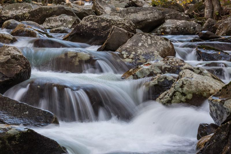 Multiple cascades of water across lichen covered rocks in the Great Smoky Mountains stock photography
