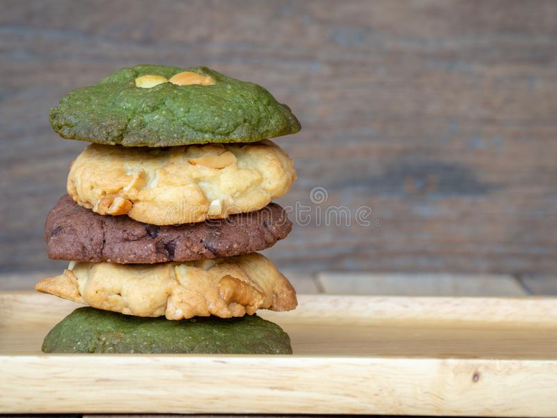 Multiple color cookies inclusive peanut butter, green tea cookies, and Chocolate Chip Cookies. Overlaid by alternating colors onMu. Multiple color cookies royalty free stock image