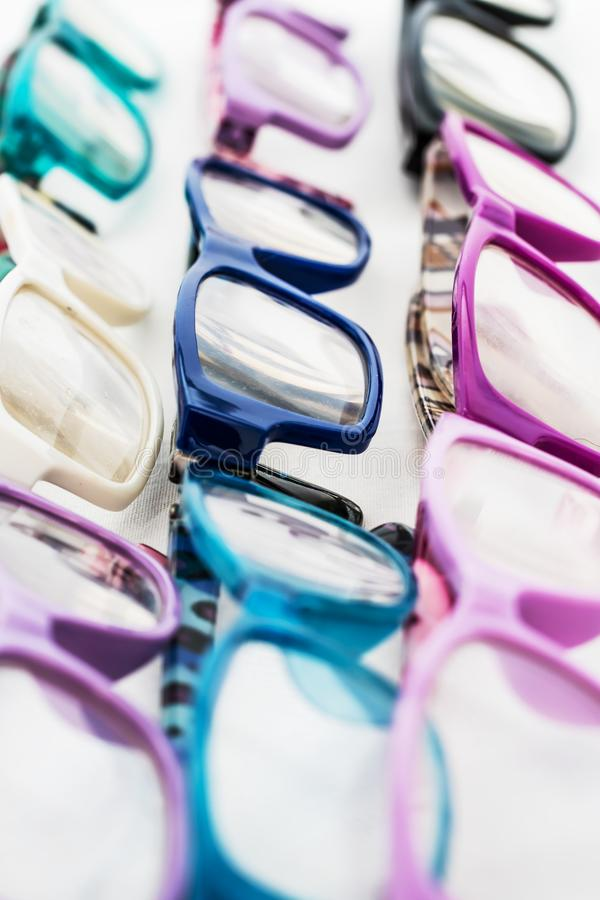 Multiple colored eye glasses and lined on white background. Eye Health Concept royalty free stock photo