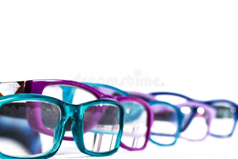 Multiple colored eye glasses smudged and lined on white background. Eye Health Concept stock photos