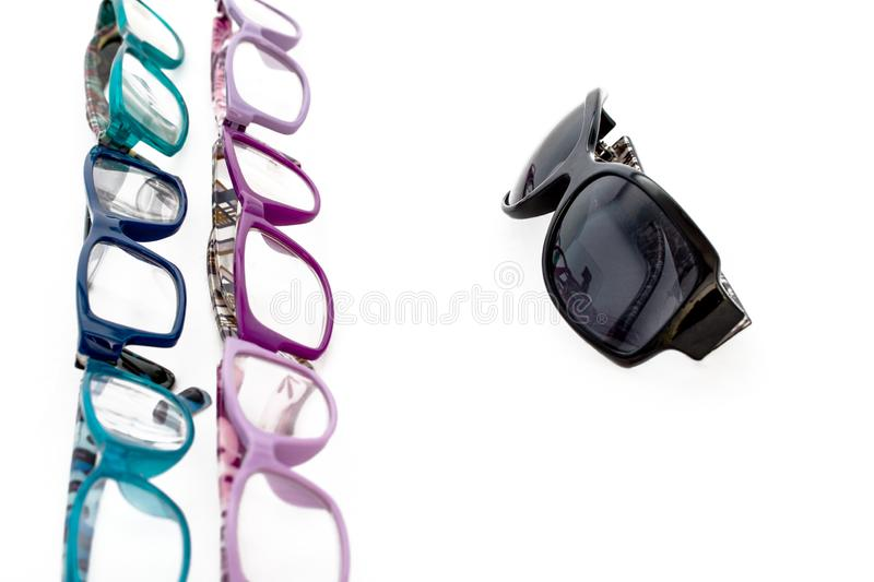 Multiple colored eye glasses and sunglasses on white background. Eye Health Concept stock photo