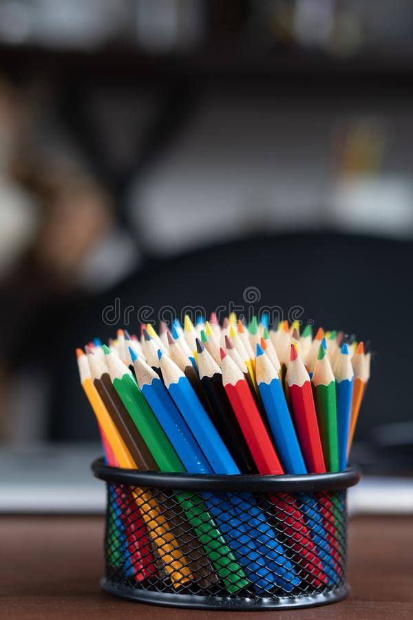 Multiple colored pencils in the box . stock photos