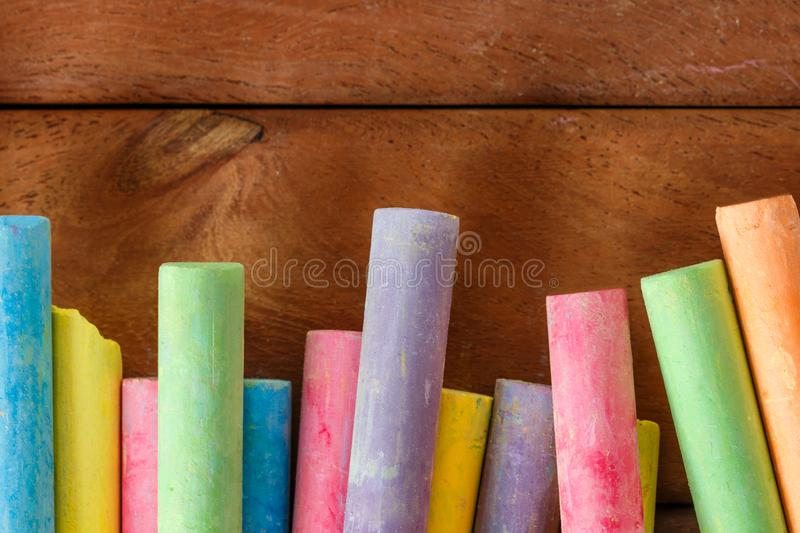 Multiple colorful chalk. On wooden floors with copy space royalty free stock photo