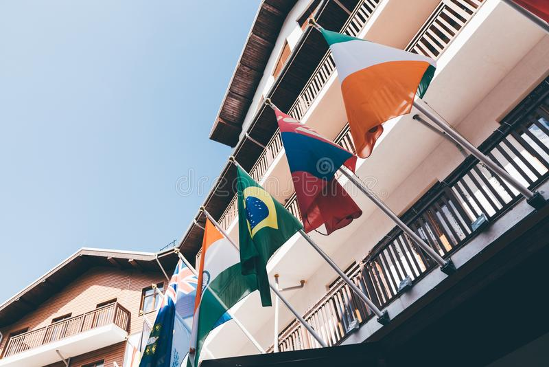 National flags fixed to facade of house royalty free stock photos
