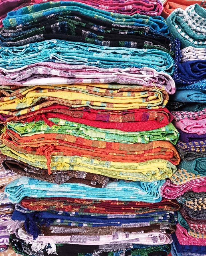 Multiple coloured dupattas stacked on top for sale stock photography