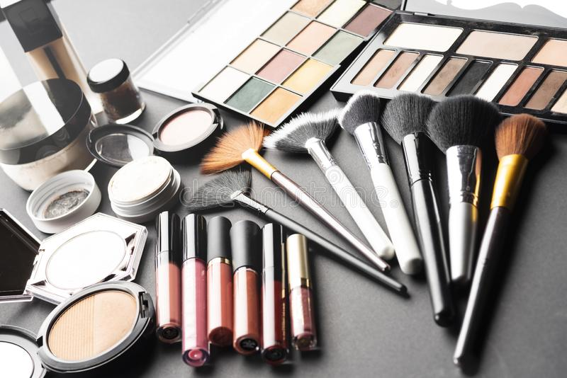 Multiple cosmetic products on black background. High resolution image for cosmetics and fashion industry royalty free stock photography