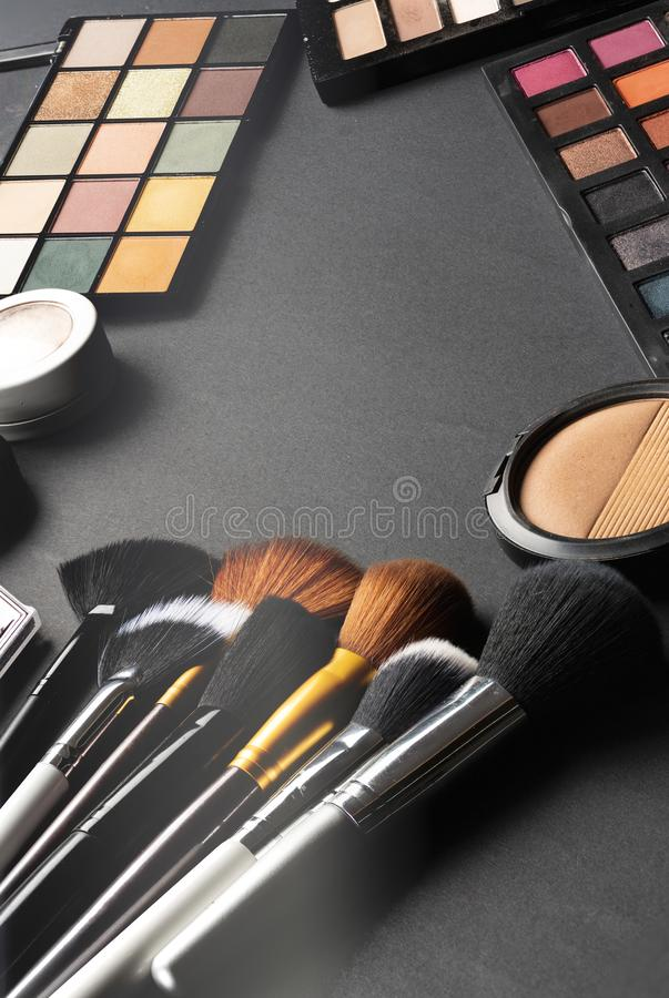 Multiple cosmetic products on black background. High resolution image for cosmetics and fashion industry royalty free stock photo