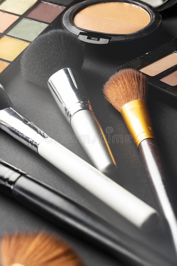 Multiple cosmetic products on black background. High resolution image for cosmetics and fashion industry stock images