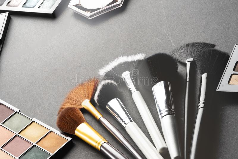 Multiple cosmetic products on black background. High resolution image for cosmetics and fashion industry stock photo