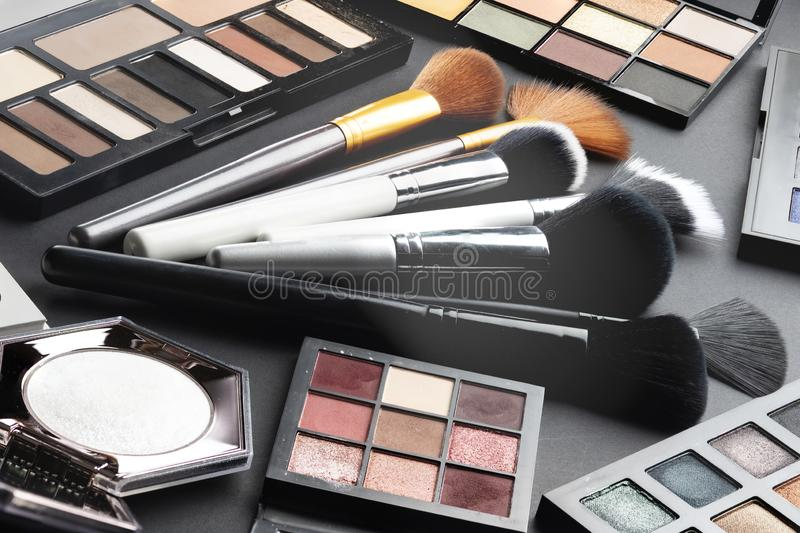 Multiple cosmetic products on black background. High resolution image for cosmetics and fashion industry stock image