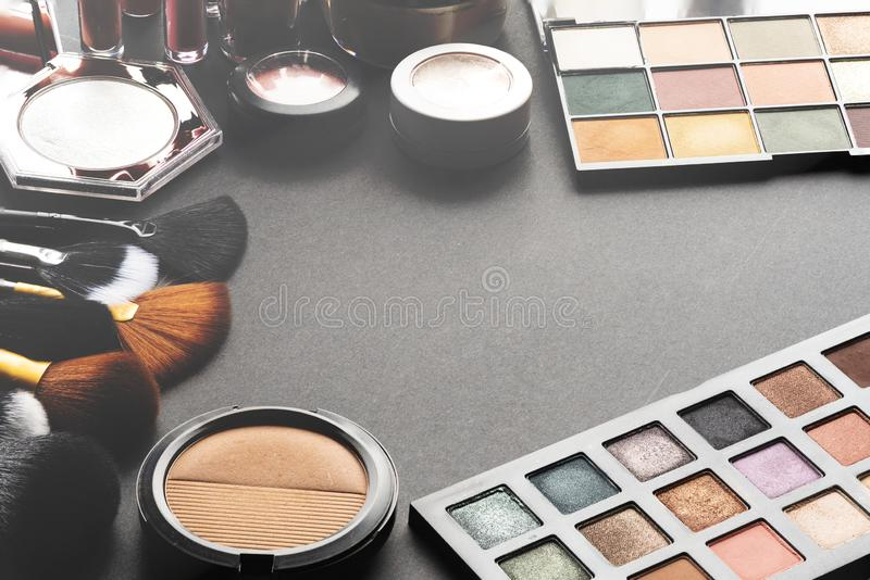 Multiple cosmetic products on black background. High resolution image for cosmetics and fashion industry royalty free stock image