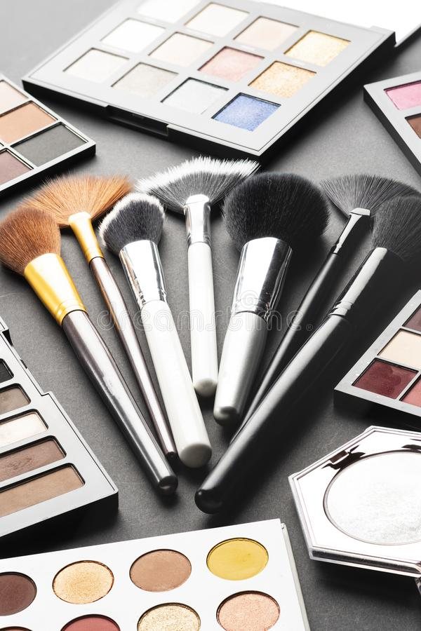 Multiple cosmetic products on black background. High resolution image for cosmetics and fashion industry royalty free stock photos