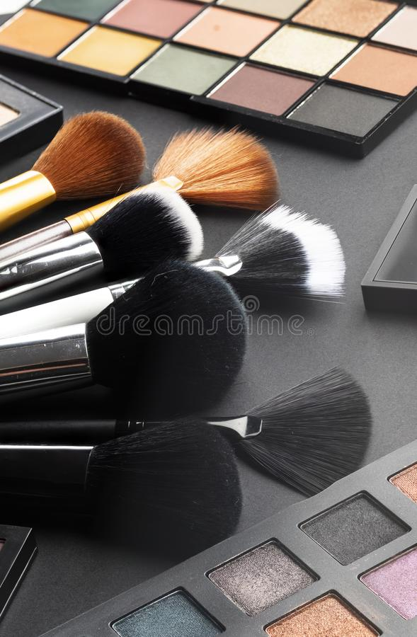Multiple cosmetic products on black background. High resolution image for cosmetics and fashion industry stock photos