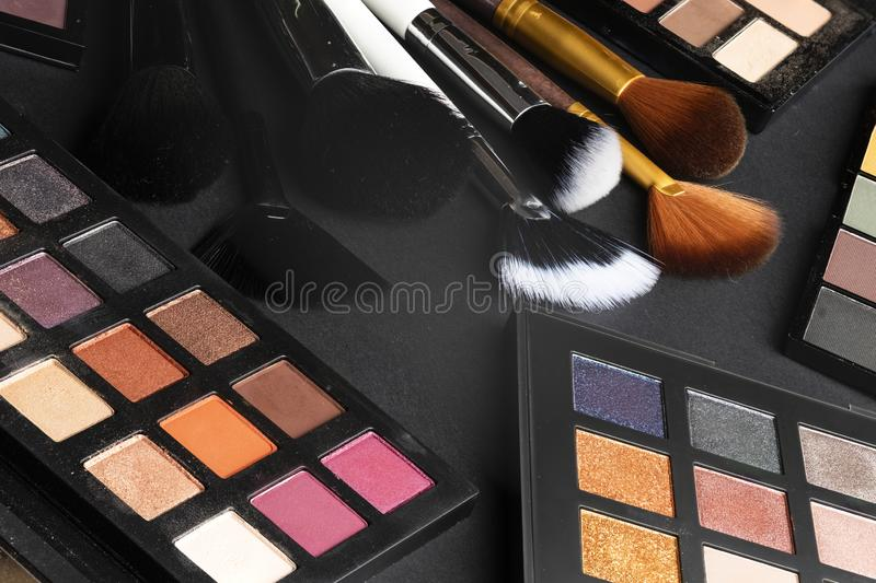 Multiple cosmetic products on black background. High resolution image for cosmetics and fashion industry stock photography