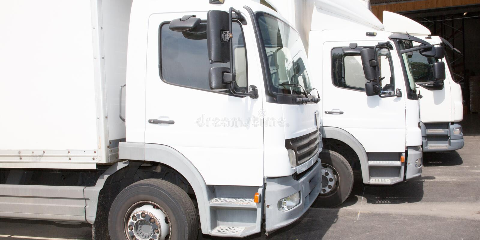 Multiple delivery small van white transportation truck park stock photography