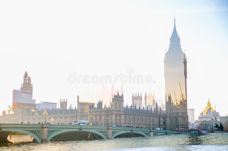 Multiple exposure image of beautiful morning on the Westminster bridge with blur of walking people. View include Big Ben and House. London, UK - November 30 stock images