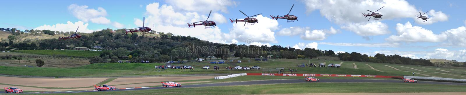 Multiple Exposures Of A Helicopter Chasing Race Car stock photography