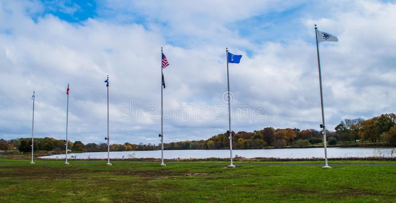 Pennsauken, New Jersey - November 5, 2017: These flag poles had flags raised at this year`s Veterans Day ceremonies royalty free stock photos