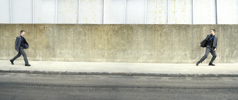 Multiple Image Of Man On Sidewalk royalty free stock photography