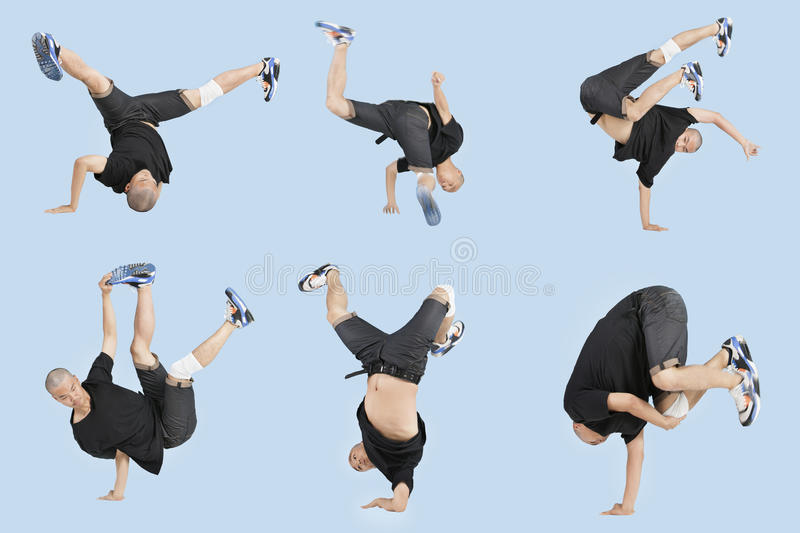 Multiple image of young man break dancing over light blue background royalty free stock images