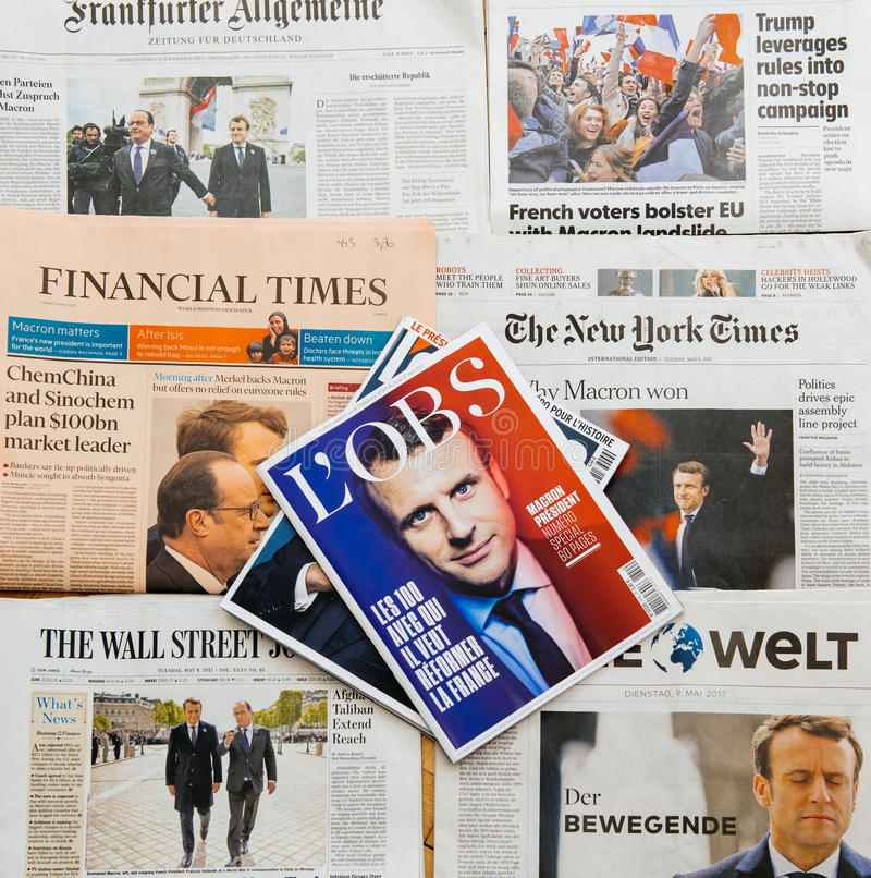 Multiple international press newspaper with Emmanuel Macron Election as Frenc President. PARIS, FRANCE - MAY 10, 2017: l`Obs magazine above multiple stock photo