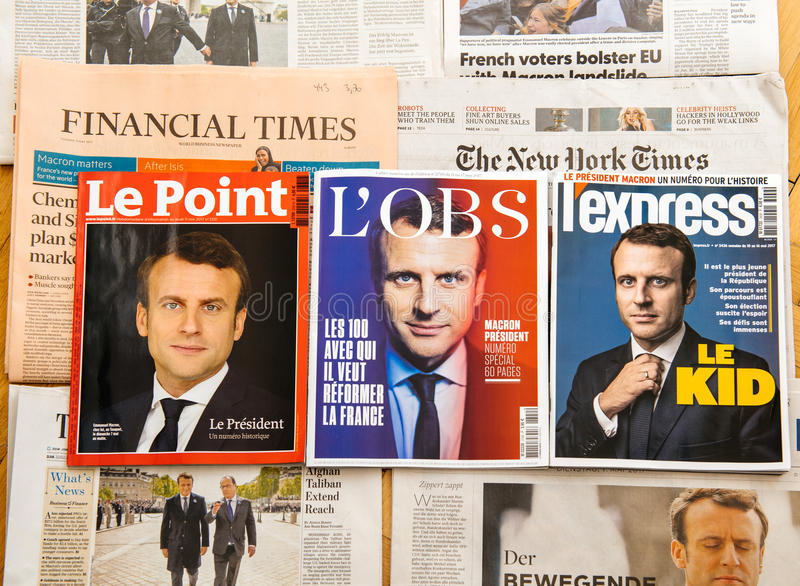 Multiple international press newspaper with Emmanuel Macron Election as Frenc President. PARIS, FRANCE - MAY 10, 2017: Le Point, L`Express, L`Obs above multiple royalty free stock images