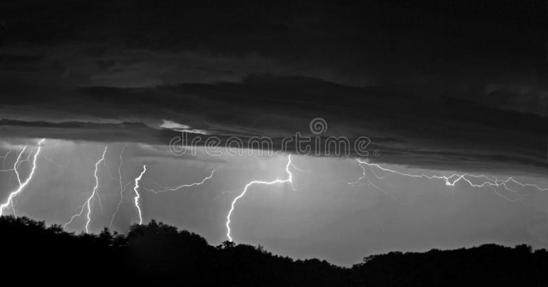 Multiple Lighting Strikes Woods clouds composite panorama stock image