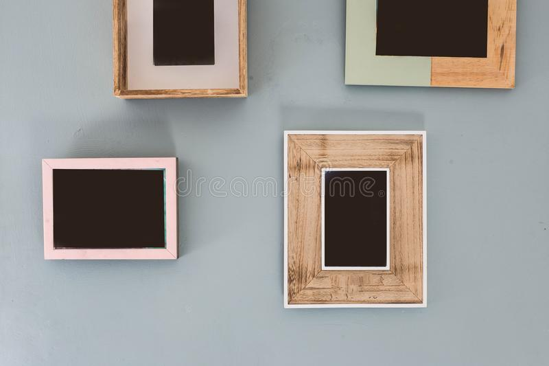 Multiple many blank small picture frames on colorful wall royalty free stock photos