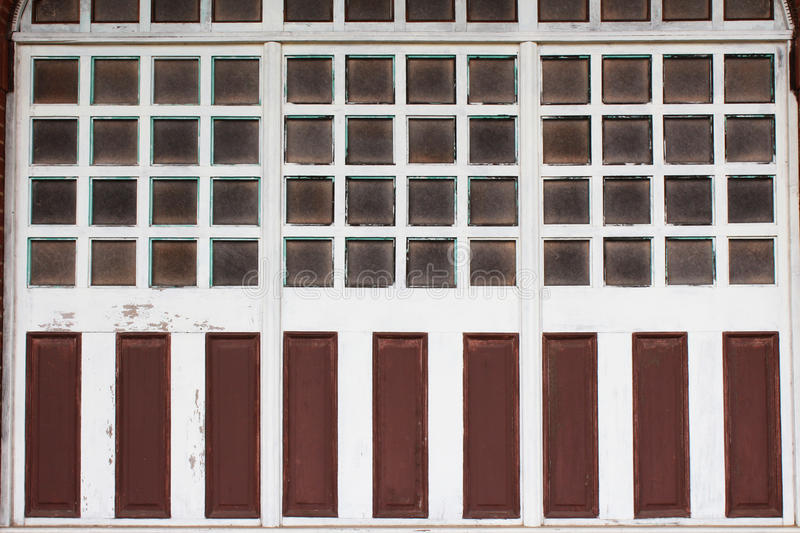 Download Multiple Panes Of Glass In Wood Window Frames With Weathered Paint Panels Stock Image