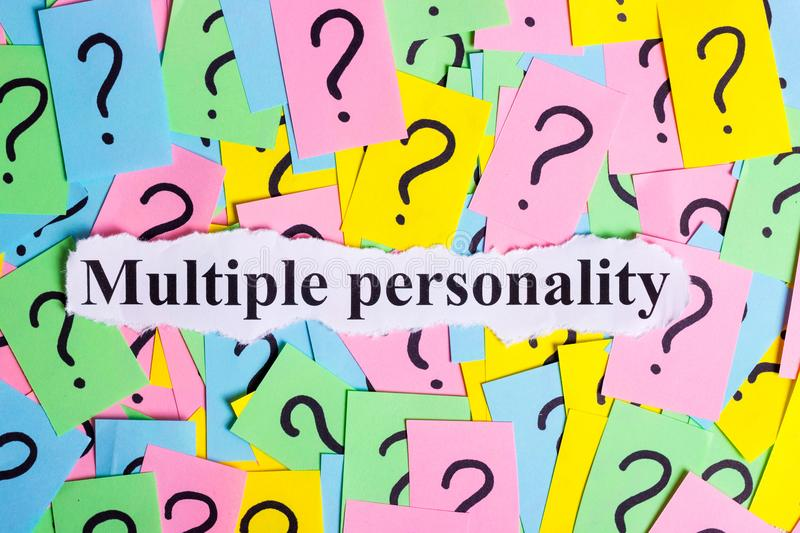 Multiple personality Syndrome text on colorful sticky notes Against the background of question marks.  royalty free stock photos