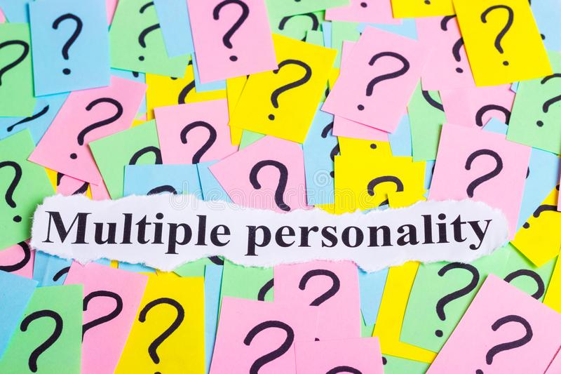 Multiple personality Syndrome text on colorful sticky notes Against the background of question marks.  stock photography