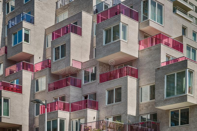 Multiple pink glass blocked balconies, apartments at the zuidas in Amsterdam, luxery apartments, living, houses. Amsterdam, George Gershwinlaan, The Netherlands royalty free stock image