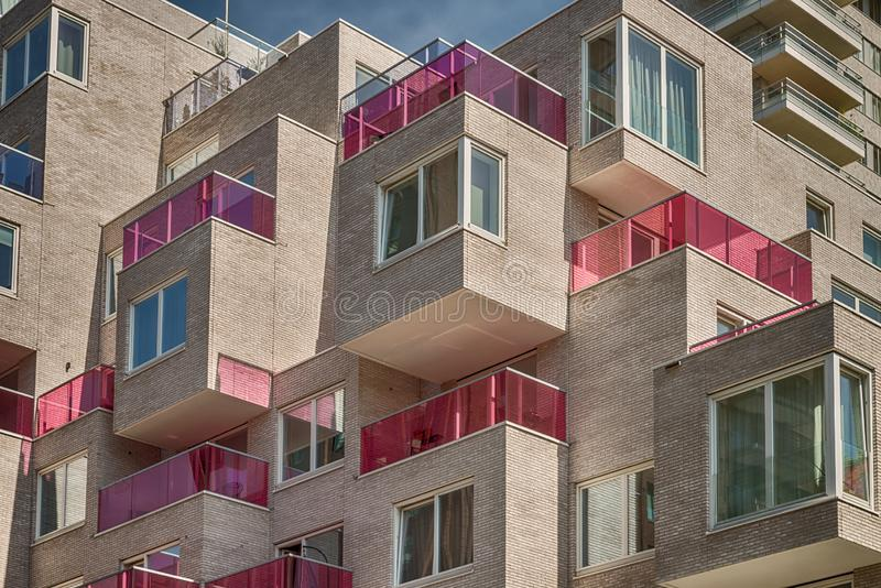 Multiple pink glass blocked balconies, apartments at the zuidas in Amsterdam, luxery apartments, living, houses. Amsterdam, George Gershwinlaan, The Netherlands stock images
