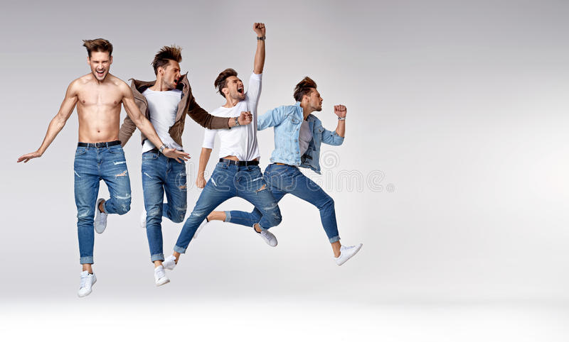 Multiple portrait of a jumping smart guy stock image