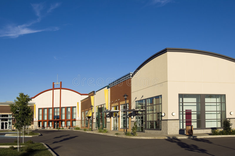 Multiple retail stores. Empty store front. Strip Mall stock image