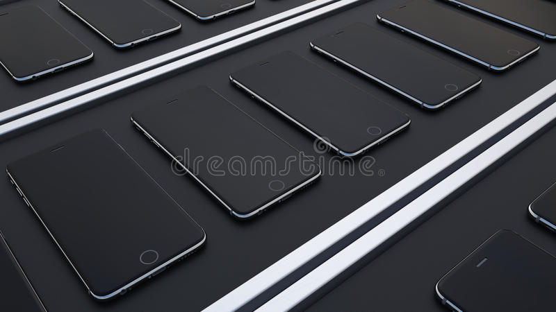 Multiple smartphones moving on the conveyor belts. Hi-tech mobile phone production line royalty free stock photography