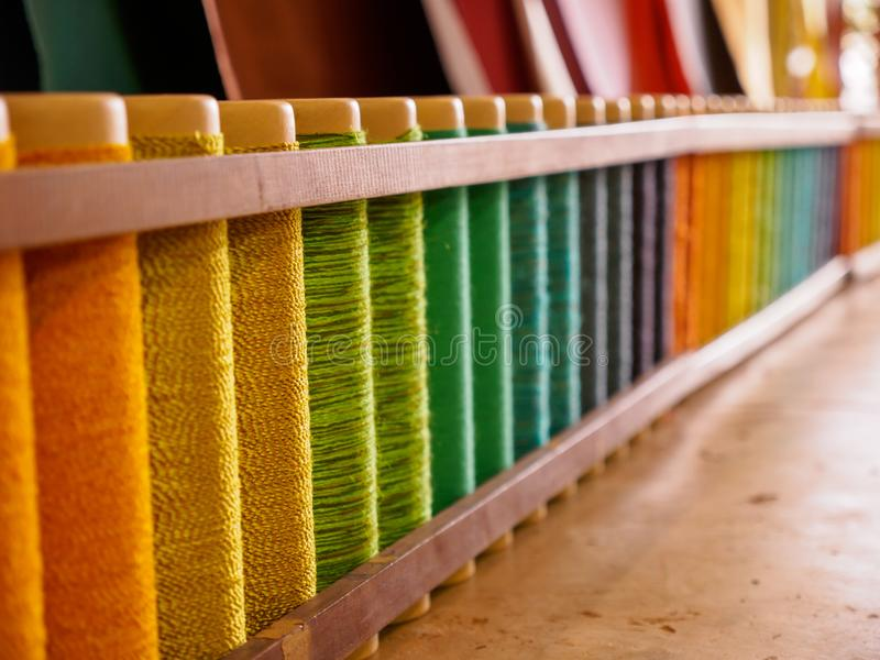 Multiple spools of colorful hand spun silk threads, Thailand. Close-up detail of multiple spools of colorful, shiny textured silk threads, hand spun by local royalty free stock photos