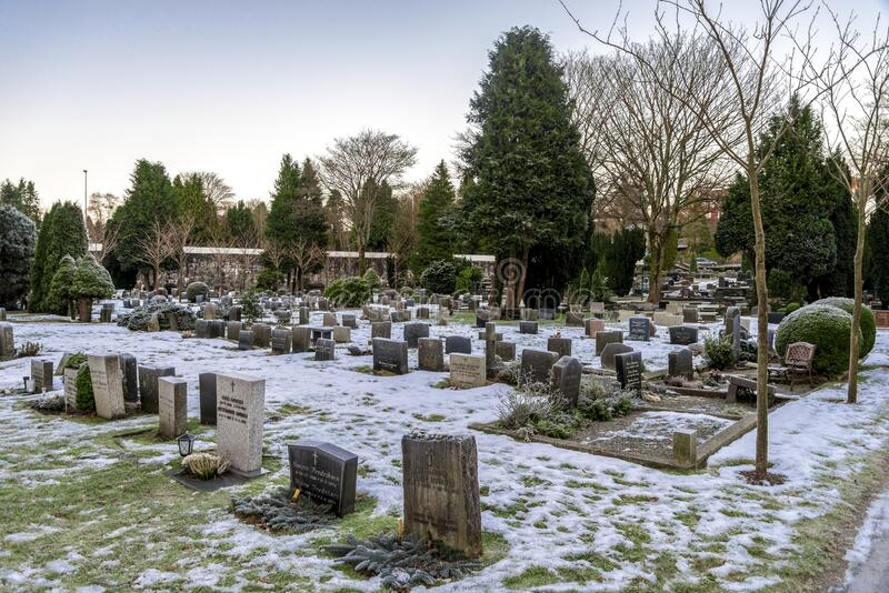 Multiple tombstones and snow covered ground in scenic Lagard cemetery during winter season, Stavanger. Norway, December 2017 royalty free stock images