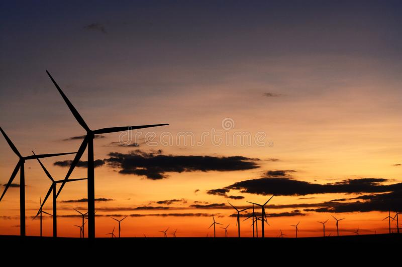 Many wind turbines or wind farm at sunset. Multiple wind turbines or wind farm at sunset stock photos