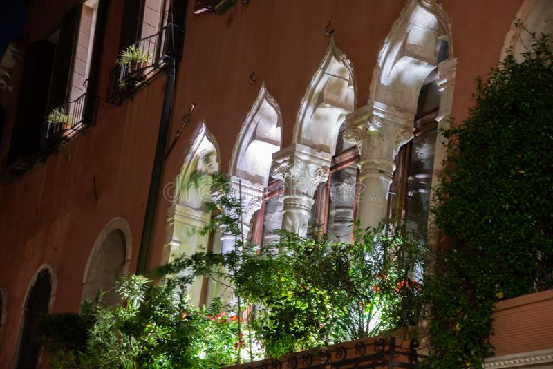 Night photography of typical windows four-windowed in Venice, Italy. stock images