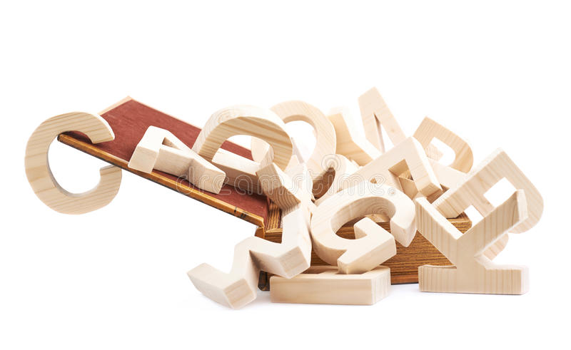 Multiple wooden letters in a book royalty free stock photos
