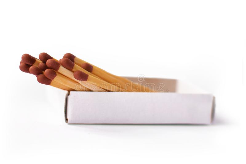 Multiple wooden matchsticks with brown heads in box stock images