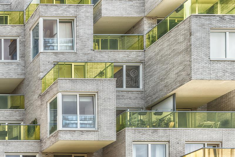 Multiple yellow glass blocked balconies, apartments at the zuidas in Amsterdam, luxery apartments, living, houses. Amsterdam, George Gershwinlaan, The stock photo