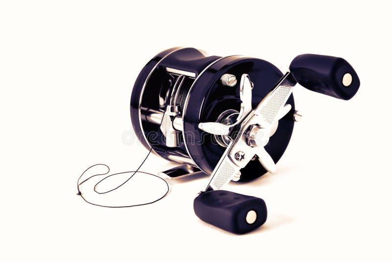 Multiplicador com inércia preto com o isolado da ferida do cabo, close-up do carretel fotos de stock