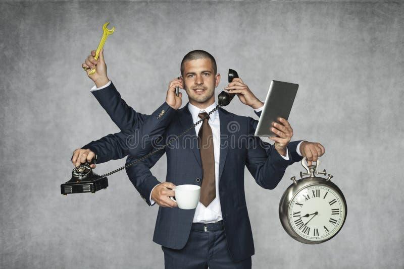 Multipurpose businessman stock photography