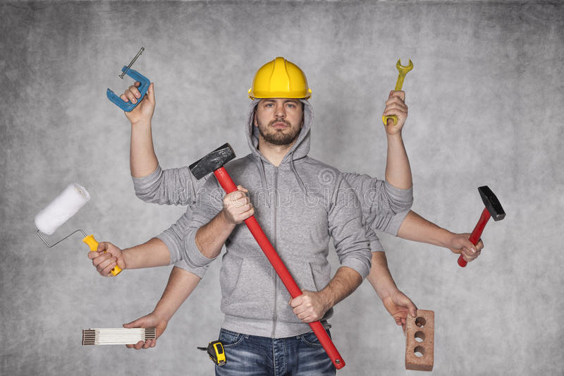Multipurpose man. Worker with many hands stock image