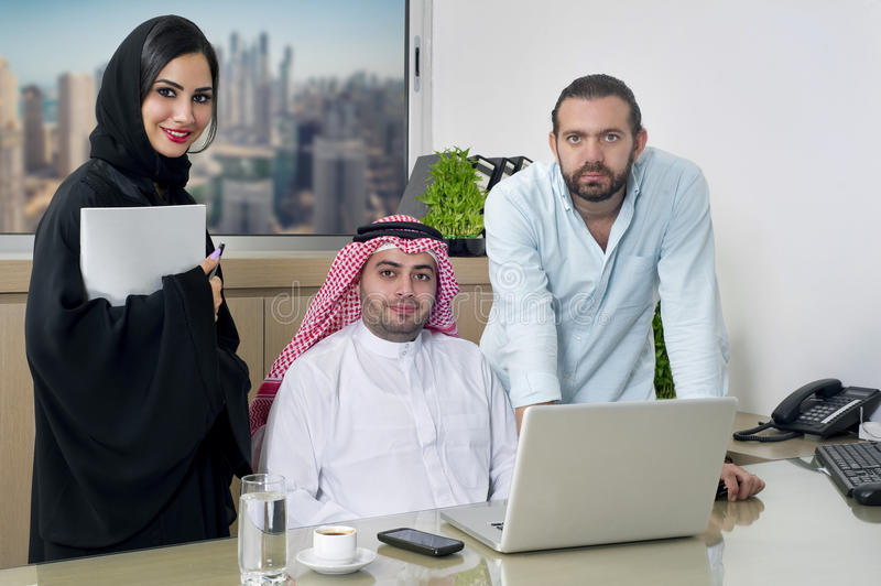 Multiracial Business Meeting in office , arabian businessman & arabian Secretary wearing hijab & a Foreigner meeting in office royalty free stock images
